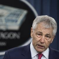 U.S. Secretary of Defense Chuck Hagel announces plans Friday to bolster the country's defenses against a possible North Korean missile strike by siting 14 more interceptors in Alaska. | AP