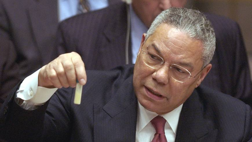 U.S. Secretary of State Colin Powell holds up a vial that he said could contain anthrax during a U.N. Security Council meeting on Feb. 5, 2003.