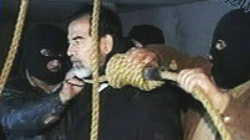 Saddam Hussein's guards place a noose around the deposed strongman's neck moments before his execution on Dec. 30, 2006, in the Iraqi capital. | AP