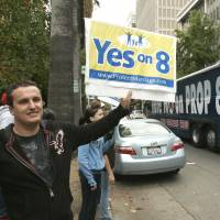 Courting voters: A man holds up a 'Yes on 8' sign as a bus passes, bearing another sign to 'Vote No On Prop 8,' in Sacramento, California, in November 2008. The Supreme Court can choose from a wide array of outcomes in ruling on California's Proposition 8 ban on same-sex marriage and the federal Defense of Marriage Act (DOMA), which defines marriage as the union of a man and a woman. The cases will be argued Tuesday and Wednesday; rulings are not likely before late June. | AP
