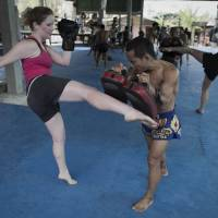 Again, with feeling!: A student belts out some kicks at the  Tiger training camp. | AFP-JIJI