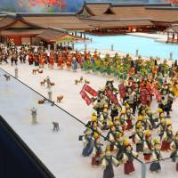 A model themed on Miyajima Kiyomori Matsuri, a Heian Era festival, featuring part of Itsukushiwa Shrine complex with warriors and courtesans made from marzipan and other treats. | SATOKO KAWASAKI
