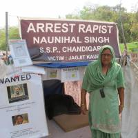 Street justice: Mahinder Kaur protests for her daughter, whom the mother says was raped in 2010 by a policeman in Punjab state, on Friday.   THE WASHINGTON POST