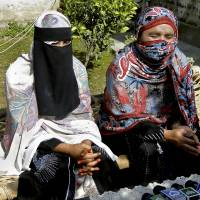 Tribal tribulations: Badam Zari (right) speaks at a news conference with her sister in Khar, capital of the Pakistani tribal region of Bajur, on Monday. Zari is the first woman to run for Parliament from the area, a known haven for Islamist militants. | AP