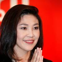 Yingluck seeks constitutional change amid court challenge
