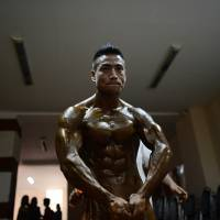 Strike a pose: A bodybuilder rehearses ahead of the final SEA Games selection contest in February in Yangon. | AFP-JIJI