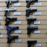 Firearms are showcased at a busy mall in the Philippine capital the same day. | AFP-JIJI
