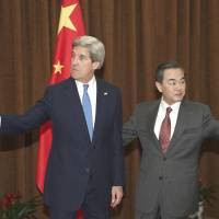Here and there: U.S. Secretary of State John Kerry and Chinese Foreign Minister Wang Yi are seen in Beijing on Saturday. | AFP-JIJI
