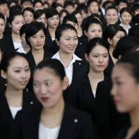 Flying high: While these new recruits with Japan Airlines are now gainfully employed, many single women in Japan struggle to survive on low salaries. | BLOOMBERG