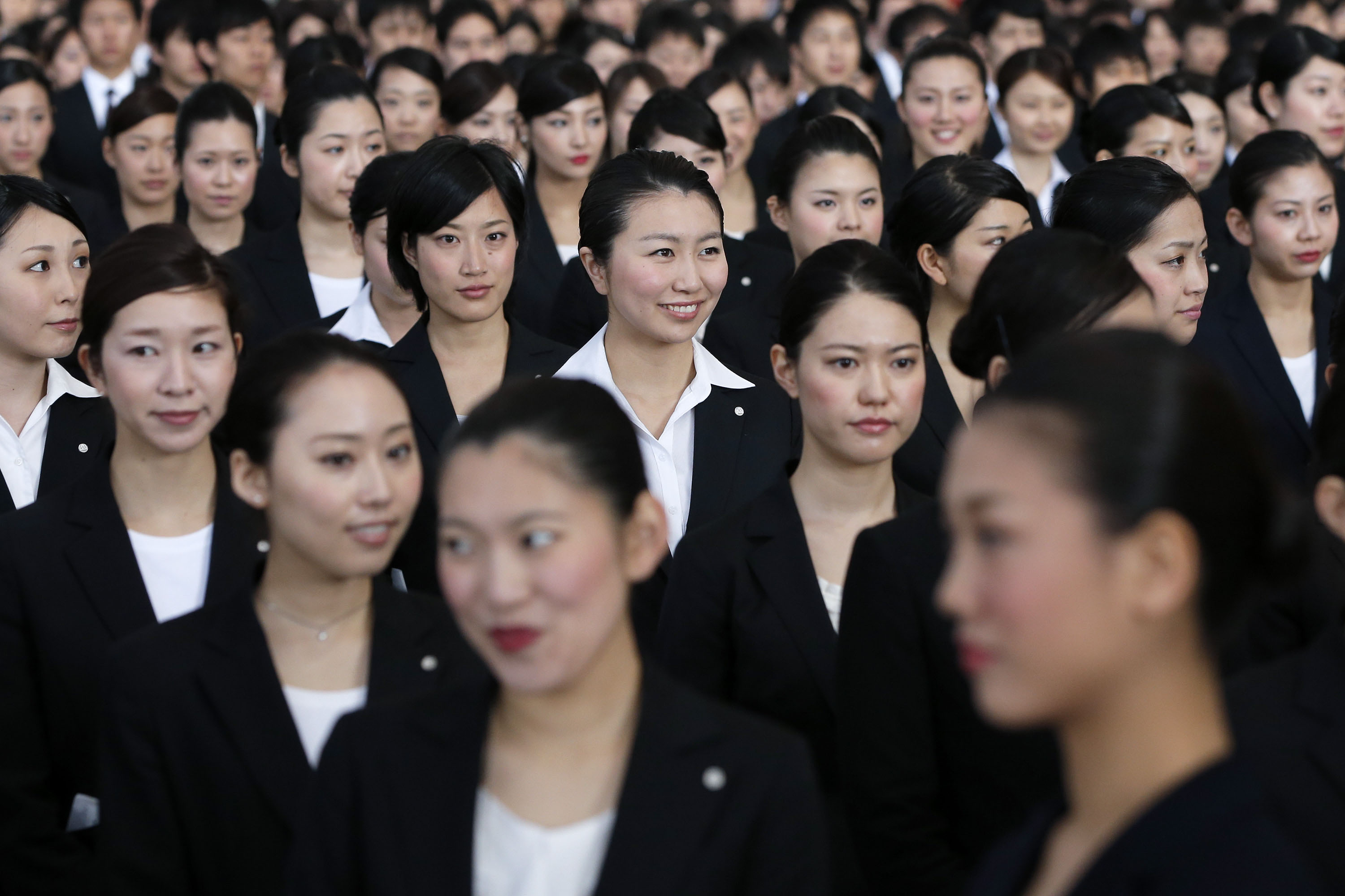Flying high: While these new recruits with Japan Airlines are now gainfully employed, many single women in Japan struggle to survive on low salaries.   BLOOMBERG
