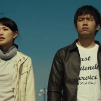 Uncertain future: After her husband dies in an industrial accident, Shiori (Asami Usuda, left) finds her life and her workplace in tatters — but forms an unexpected bond with Takumi (Takahiro Miura, right), the man responsible for his death. | © 2013