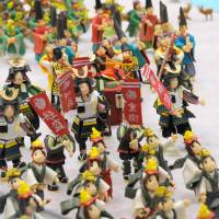 Don't forget your toothbrush: The 26th National Confectionary Exposition, running now in Hiroshima, boasts 6,000 snacks from around Japan and intricate sugary sculptures, such as these sweet warriors. | SATOKO KAWASAKI