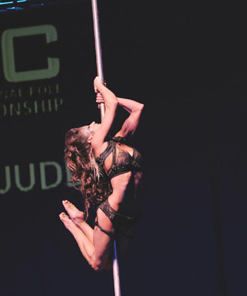 Hangin' out: Zoraya Judd, U.S. winner of the Women's Pole Art category of the 2010 International Pole Championship in Tokyo, steals the fashion show, too.
