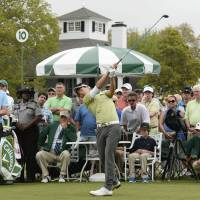 Ryo Ishikawa of Japan tees off on the 10th hole during the first round of the Masters golf tournament on Thursday in Augusta, Georgia. | KYODO