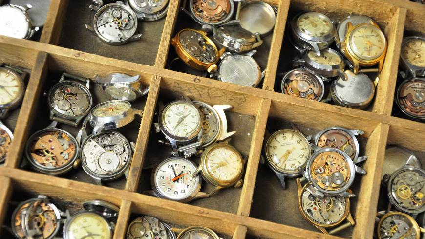 He's one of the few watchmakers left in the city who can fix quartz and mechanical watches such as these (above left) that date back decades.   TIM HORNYAK