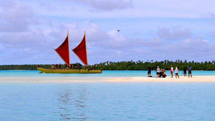 High and dry: A Japanese crew uses a drone in making a film on Aitutaki atoll about traditional oceangoing outrigger canoes like this.