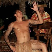 Beat that!: Musicians drum up the past for a traditional dancer at Highland Paradise on Rarotonga. | CHRISTOPHER JOHNSON