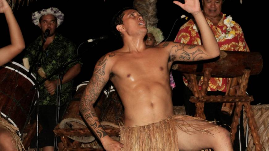 Beat that!: Musicians drum up the past for a traditional dancer at Highland Paradise on Rarotonga.   CHRISTOPHER JOHNSON