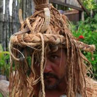 Grass hat: A dance performer at Highland Paradise sports a traditional warrior helmet adorned with wild boar tusks.   CHRISTOPHER JOHNSON