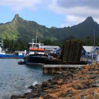 Heights from the deep: The picturesque harbor at Avarua on Rarotonga nestles under the peaks of a volcano that rises 4,500 meters from the ocean floor.   CHRISTOPHER JOHNSON
