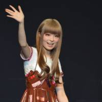Sweet stuff: Kyary Pamyu Pamyu waves to her legions of fans, as she sports a melted-chocolate dress typical of her unique sense of style. | SAMUEL THOMAS