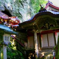 Ancient Takuhi Shrine that emerges from a hilltop cave.   ANGELES MARIN PHOTO