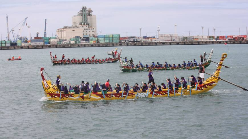 Trad fest: Dragon boats race at Naha Hari.