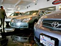 Looking for buyers: Toyota vehicles are on display in the showroom of Curry Toyota in Cortlandt Manor, N.Y., on May 31, 2007. | BLOOMBERG PHOTO