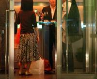 Toasting the recession: Patrons drink at the Heartland bar in Mori Tower at the Roppongi Hills complex in Tokyo on Tuesday evening. About 100 unemployed finance professionals have been invited to a 'pink slip party' to be held at the bar on April 14. | BLOOMBERG