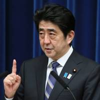 Riding high: Prime Minister Shinzo Abe holds a news conference at the Prime Minister's Official Residence on March 11. | BLOOMBERG