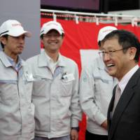 New launch: Toyota Motor Corp. President Akio Toyoda celebrates the start of Crown sedan production at the Motomachi plant in Toyota, Aichi Prefecture, on Jan. 17. | BLOOMBERG