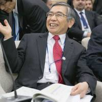 Money talks: Bank of Japan Gov. Haruhiko Kuroda attends a meeting of the International Monetary and Financial Committee in Washington on Saturday. | BLOOMBERG