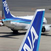 Ready for takeoff: All Nippon Airways Co. planes sit on the tarmac at Haneda airport in Tokyo on Monday. | BLOOMBERG