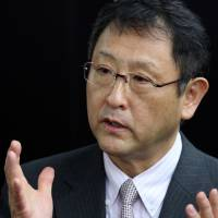 Leaving them in the dust: Akio Toyoda, president of Toyota Motor Corp., speaks to the media in Toyota, Aichi Prefecture, on Jan. 17.   BLOOMBERG