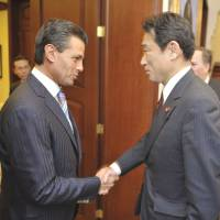 Mexican meeting: Mexican President Enrique Pena Nieto greets Foreign Minister Fumio Kishida in Mexico City on Monday. | AFP-JIJI
