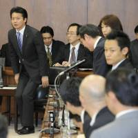 Pro forma: Foreign Minister Koichiro Genba stands to bow in appreciation after bilateral nuclear agreements with four countries pass the Lower House Foreign Affairs Committee on Friday. | KYODO