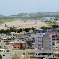 Fixed position: U.S. Marine Corps Air Station Futenma in Ginowan, Okinawa Prefecture, is seen in June. | KYODO PHOTO