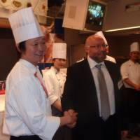 Numero Uno: Daisuke Yamazaki, a chef in Tokyo's Ginza district, is congratulated Wednesday by Francesco Formiconi, president of the Italian Chamber of Commerce in Japan, after winning an Italian cooking competition. | KYODO PHOTO