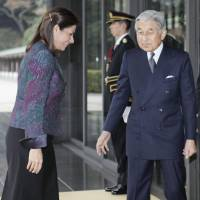 Comes with the job: Emperor Akihito greets visiting Costa Rican President Laura Chinchilla at the Imperial Palace on Dec. 8. | AP PHOTO