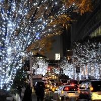 All aglow: Trees at the Roppongi Hills complex in Minato Ward, Tokyo, glitter with white and blue LED lights on Dec. 13. Below, a garden at nearby Tokyo Midtown is covered with blue LED lights.   SATOKO KAWASAKI PHOTOS