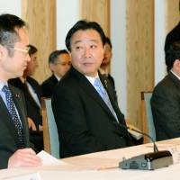 Money matters: Prime Minister Yoshihiko Noda (center), economic and fiscal policy minister Motohisa Furukawa (left) and Chief Cabinet Secretary Osamu Fujimura attend a Cabinet meeting on the fiscal 2012 budget at the Prime Minister's Official Residence on Saturday. | KYODO PHOTO