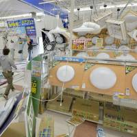 Repairs get underway at an electronics store in Sumoto, Hyogo Prefecture, following a 6M earthquake that jolted western Japan Saturday morning.  | KYODO