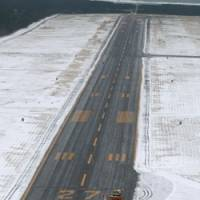 An aerial photo over Shonai Airport in Yamagata Prefecture shows where an  ANA flight landed after after overshooting the runway Saturday evening. | KYODO