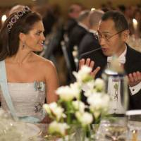 Much to discuss: Shinya Yamanaka speaks with Swedish Princess Madeleine at the 2012 Nobel Prize Banquet in Stockholm on Monday. | AP