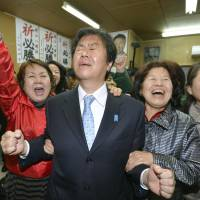 Former internal affairs minister Kazuhiro Haraguchi reacts after winning a Lower House seat via proportional representation after failing to defend his single-seat district in Tosu, Saga Prefecture.