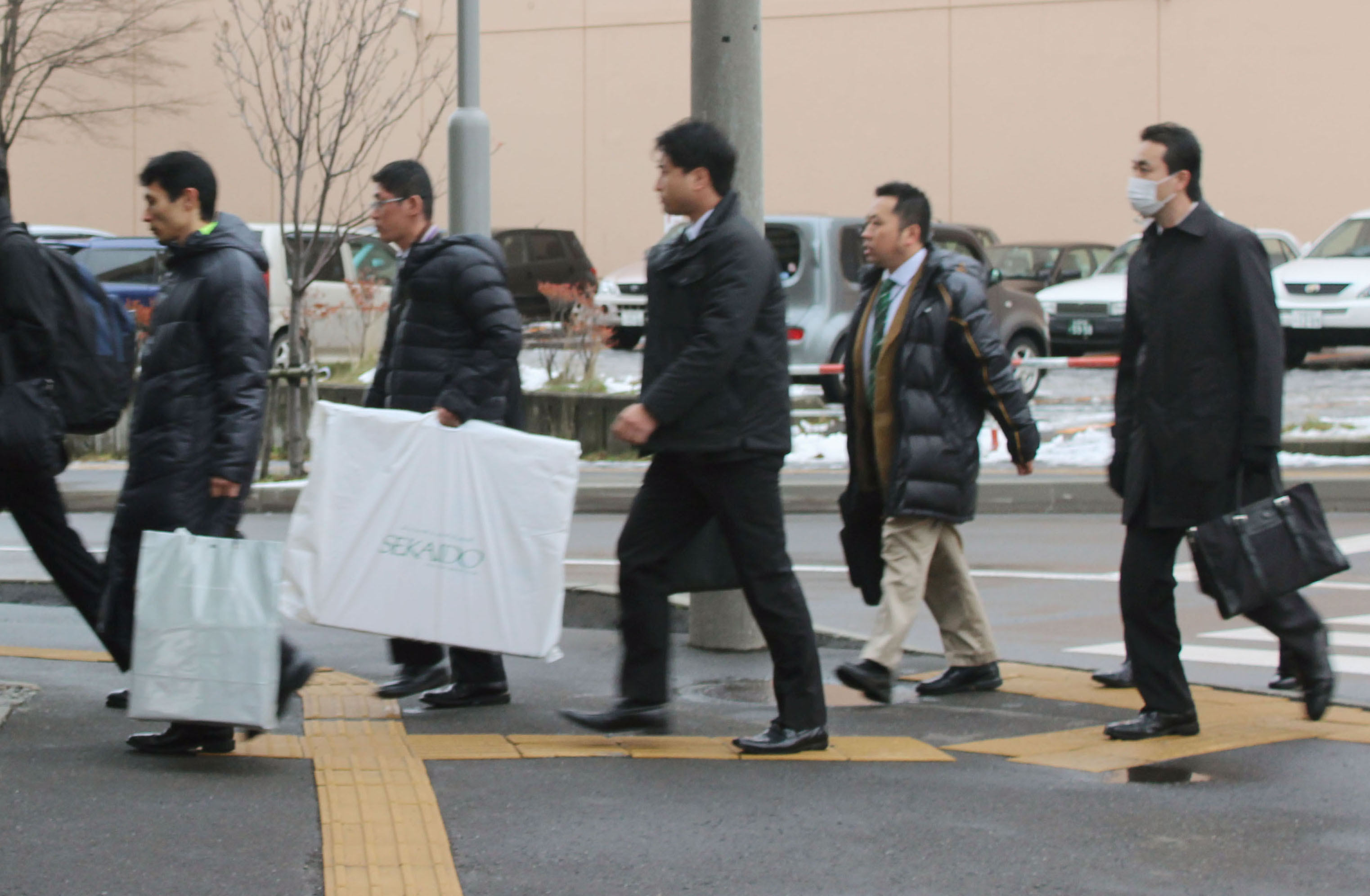 Sending a message: Police enter a company that manages 2channel's servers in Sapporo on Nov. 26. | KYODO