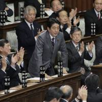 Second coming: Liberal Democratic Party leader Shinzo Abe bows after being named prime minister Wednesday.   AP