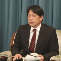 Onodera to review defense plans, up spending