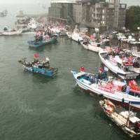 In the mix: Taiwanese fishermen leave for the Japan-held Senkaku Islands in the East China Sea in September to assert their territorial claim. China also claims the islets. | KYODO