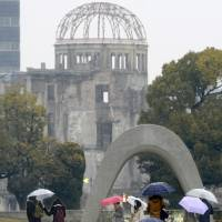 Making a pilgrimage: People walk in Peace Memorial Park in the city of Hiroshima in February. | KYODO